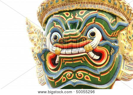 Close-up Head Of A Giant At The Emerald Buddha Temple In Thailand Isolated On White
