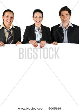 Business People Holding A White Board