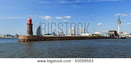 Panoramic view of Bremerhaven with historic lighthouse on the pier in foreground