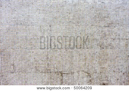 Aged Mosaic Tiles Background.