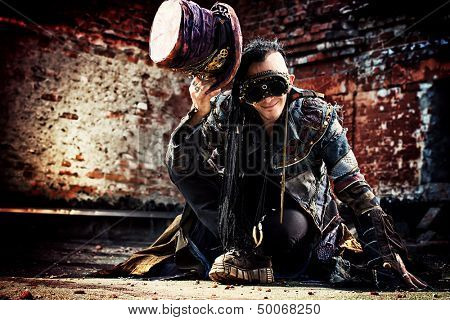 Portrait of a steampunk man in the ruins.