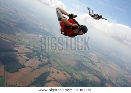 Skydiver Flies Past Cameraman