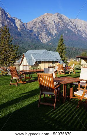 Wooden Chair And Table With Mountain Panorama