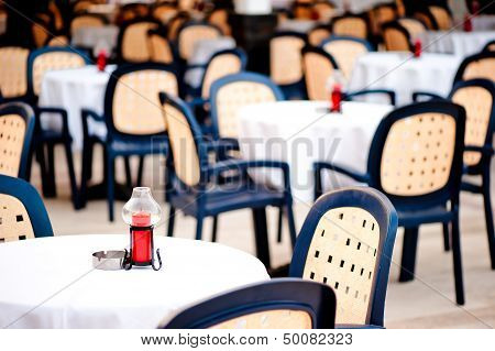 covered with a tablecloth tables for visitors to the summer outdoor cafes