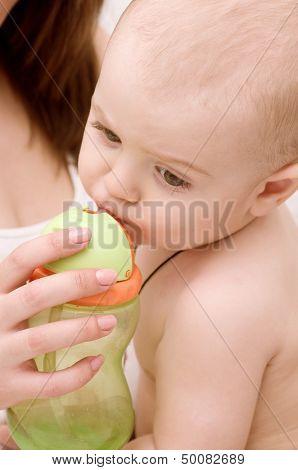 Newborn baby feet in mother's hands.