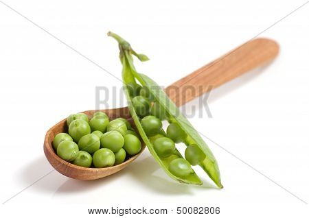 Fresh green peas in spoon isolated on a white background