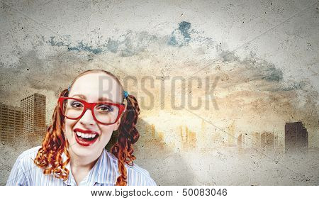 Funny looking red-hair woman with glasses staring at camera