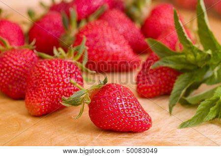 Strawberry in wooden plate isolated on white background