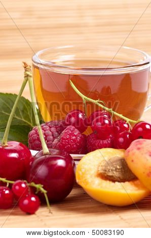 Fruit tea in cup with berry isolrted