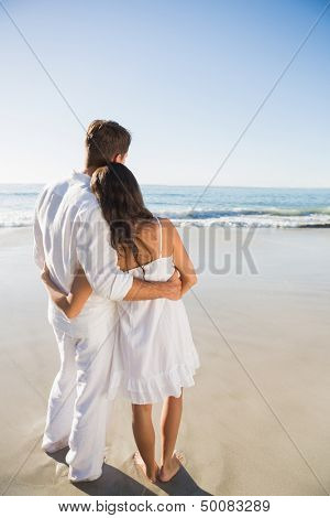 Content couple looking at the waves at the beach