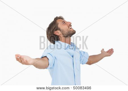 Happy man looking up with arms  on white background