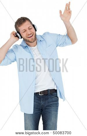Cool trendy model on white background listening to music and singing