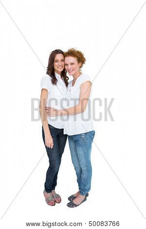 Two beautiful casual models posing on white background