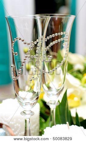 Beautiful designer wedding accessories on table .