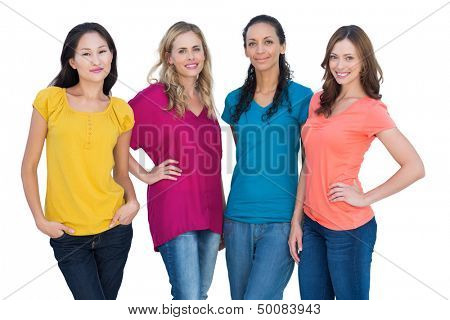 Cheerful models posing with hands on hips on white background