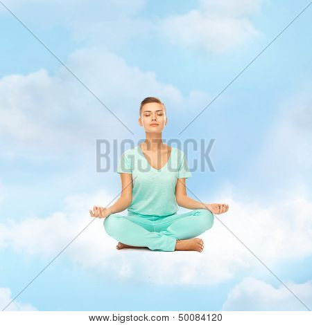 relaxation, meditation and lifestyle concept - girl on the cloud in lotus position and meditating