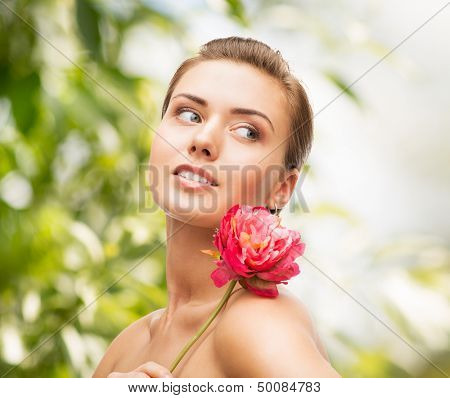 beauty, holidays and jewelry - woman with diamond earrings, ring and flower