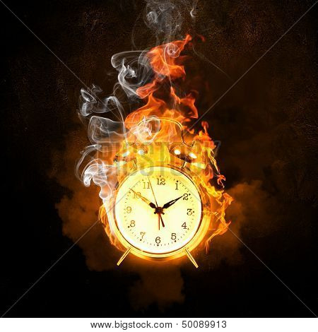 Alarm clock in fire flames. Lack of time
