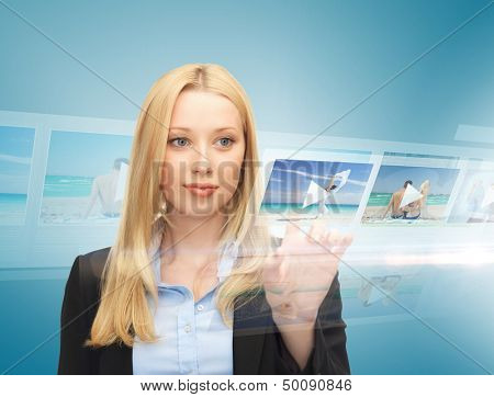technology, internet, tv and news concept - businesswoman pressing button on virtual screen with videos