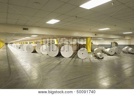 View of huge rolls of paper in spacious newspaper factory
