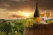 White wine with barrel on vineyard in Chianti, Tuscany, Italy poster