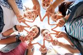 summer holidays and teenage concept - group of teenagers showing finger five gesture poster