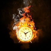 Alarm clock in fire flames. Lack of time poster