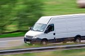 Very fast driving white van delivering goods poster