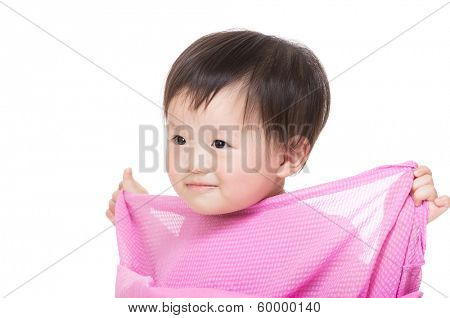 Little girl holding her dress
