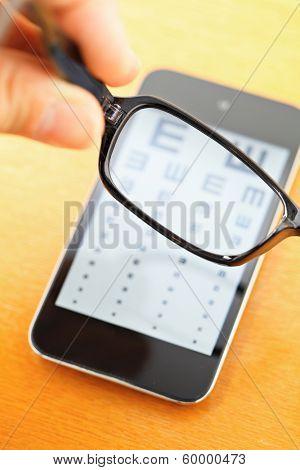 Eyechart on mobile screen with eyewear
