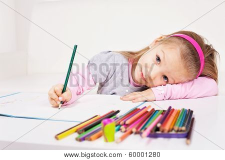 Little girl with colored pencils