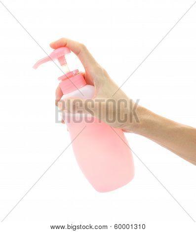 Hand apply bottle pump on white background.