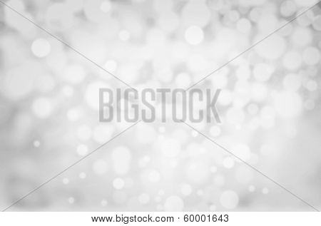 Grey Lights Festive Background. Abstract Christmas Twinkled Bright Background With Bokeh Defocused S
