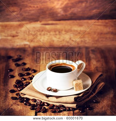 Coffee Cup And Roasted Coffee Beans  On Wooden  Brown Background, Close Up. Coffee  On A Wooden Tabl