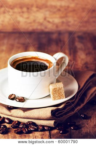 Cup Of Espresso With White Saucer And Roasted Coffee Beans  On Wooden  Brown Background With Copyspa