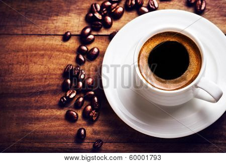 Coffee Cup With Coffee Beans  On Wooden Background With Copyspace For Text, Closeup. White Cup Of Es