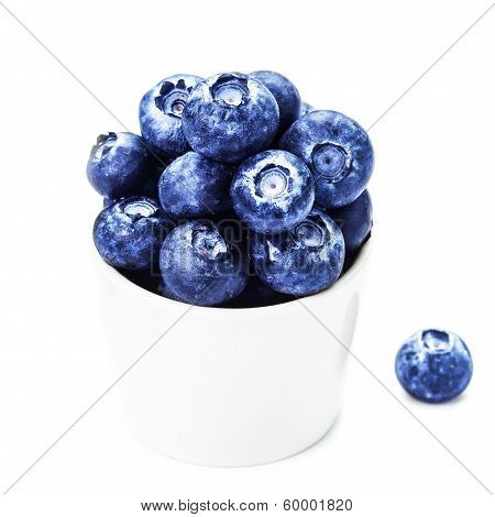Fresh Blueberries In A Bowl  Isolated On White Background Close Up.