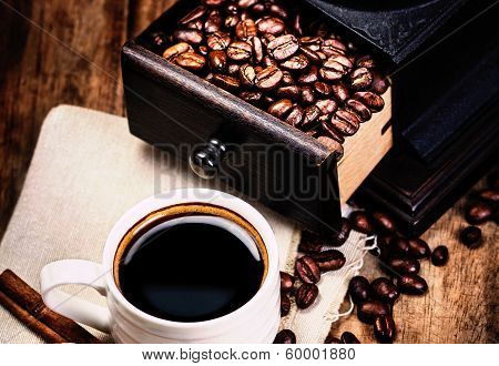 Cup Of Coffee With Coffee Beans And Coffee Grinder On Wooden Brown Background Closeup.  Espresso Cup