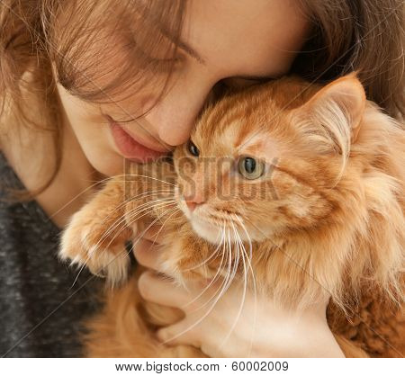Portrait Of Beautiful Young Woman 20 Years With A Fluffy Red Cat