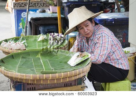 BANGKOK, THAILAND - JANUARY 24: Unknown vendor prepares and sells food on the street on Jan 24, 2014 in Bangkok, Thailand. Government figures indicate more 16,000 registered street vendors in Thailand.
