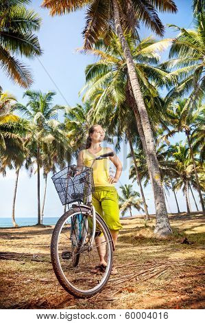 Woman With Bicycle In Nature