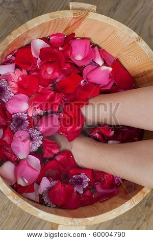 .foot Bath With Flowers In Spa Salon.
