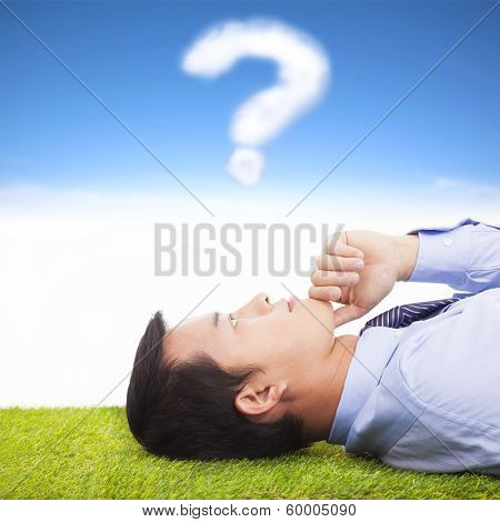 Young Businessman Thinking With  Query Symbol