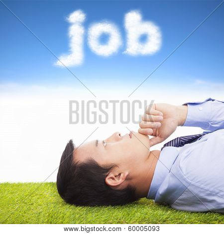 Young Businessman Thinking  On A Meadow