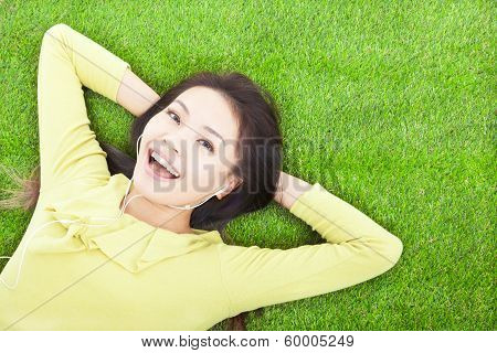 Woman Holding Head And Lying On A Meadow