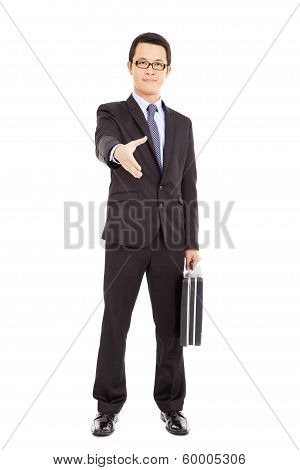 Success Businessman Holding Briefcase And Handshake