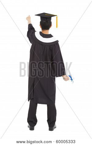 Graduation Man Wearing A Mortarboard And Pointing Somewhere