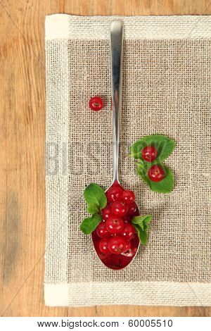 fresh red currant on shiny spoon