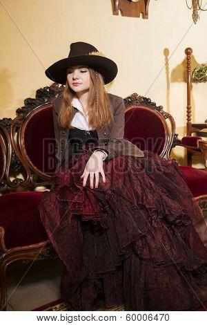Woman Sit On Expensive Soft Renaissance Furniture