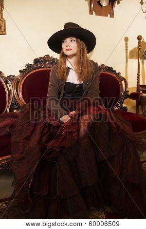 Woman At Fashioned Dress And Renaissance Furniture